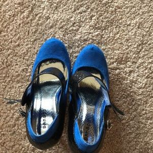 Royal blue almond toe pumps with black strap.